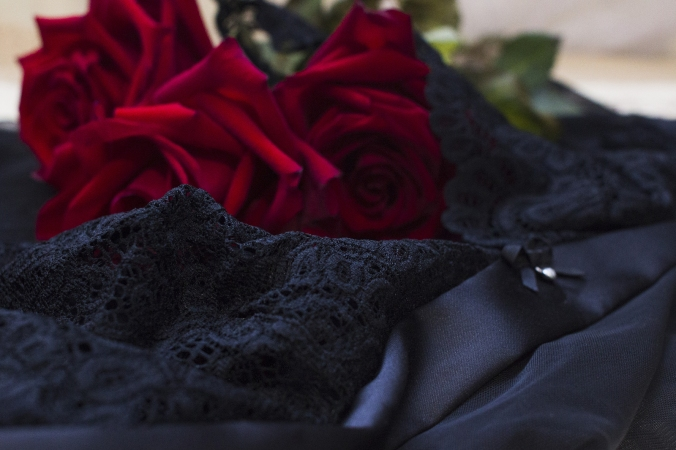 Red Roses On A Black Lace Lingerie
