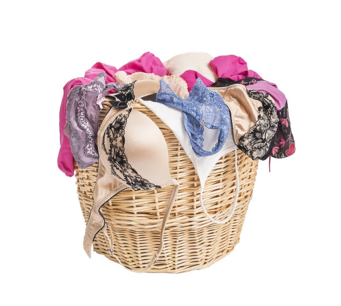 Women's underwear in the for laundry basket.