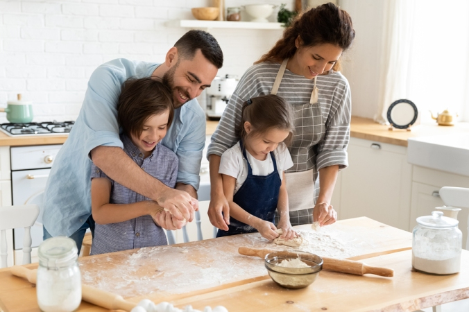 Family Feels Happy Cooking Family Recipe Pie Together In Kitchen