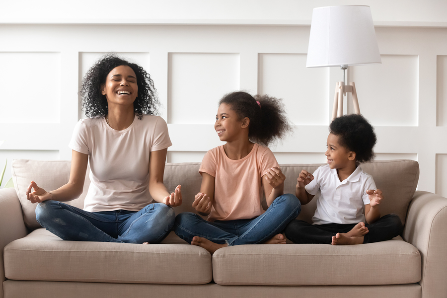 Happy Laughing Single Black Mom Meditating With Kids At Home