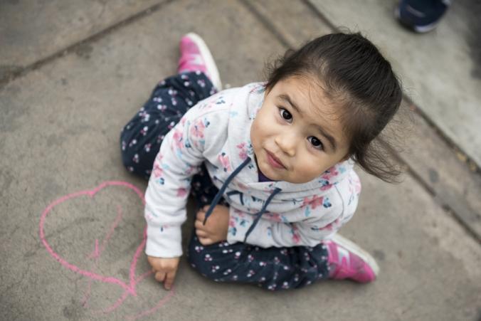 Kids Drawing With Chalk On Sidewalk. Cute.